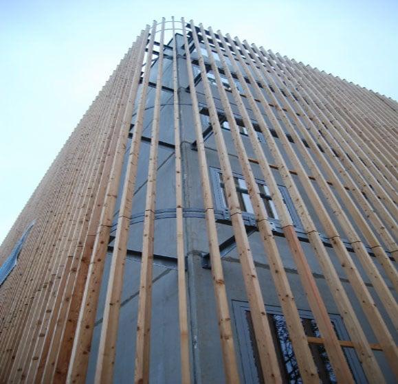 Parking a rien m tallique avec fa ades en bois for Structure metallique architecture